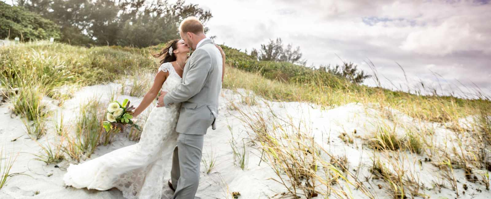 The best Miami Wedding Photographer in South Florida is Couture Bridal Photography. Image of Bride and groom in an embrace after a beach wedding ceremony