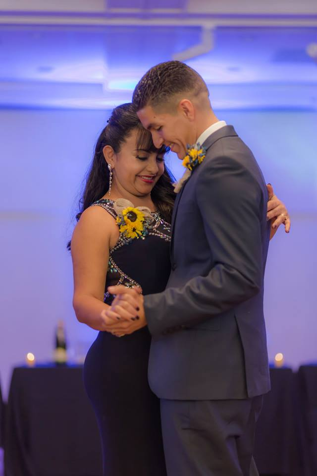 The mother of the groom and groom having their first dance during his Lakeside Terrace Wedding reception