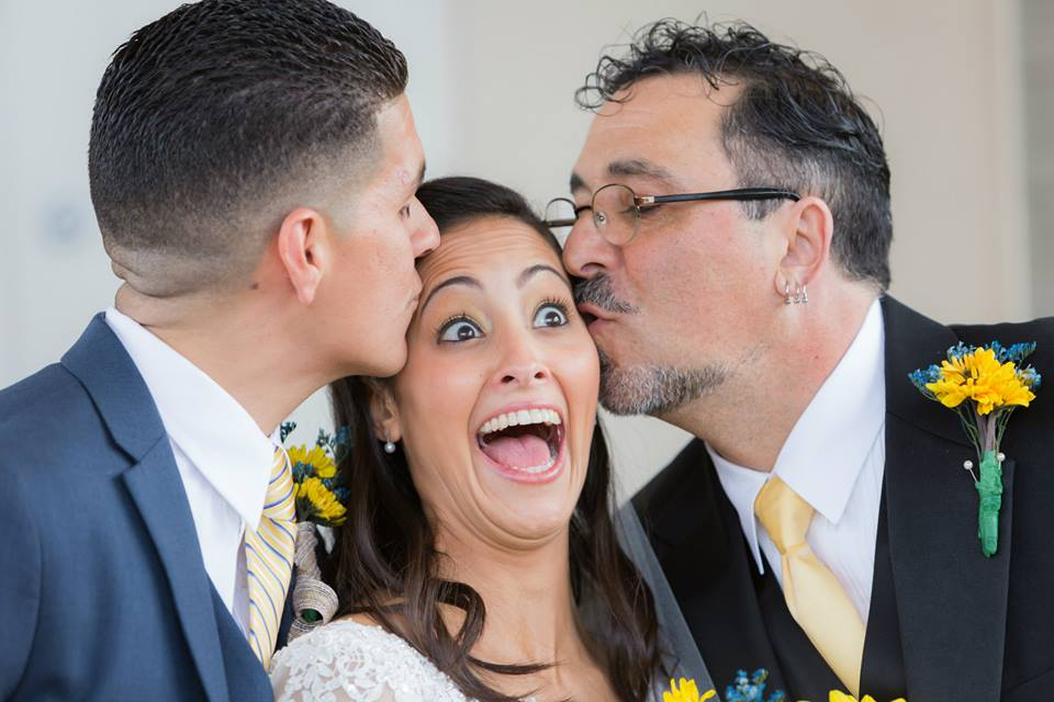The groom and brides father kissing the bride at the Boca Raton Kingdom hall after their beautiful wedding ceremony before leaving to their lakeside Terrace Wedding reception