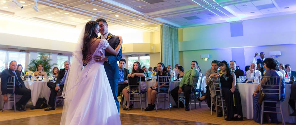 Lakeside Terrace Wedding day reception bride and grooms first dance by Couture Bridal Photography