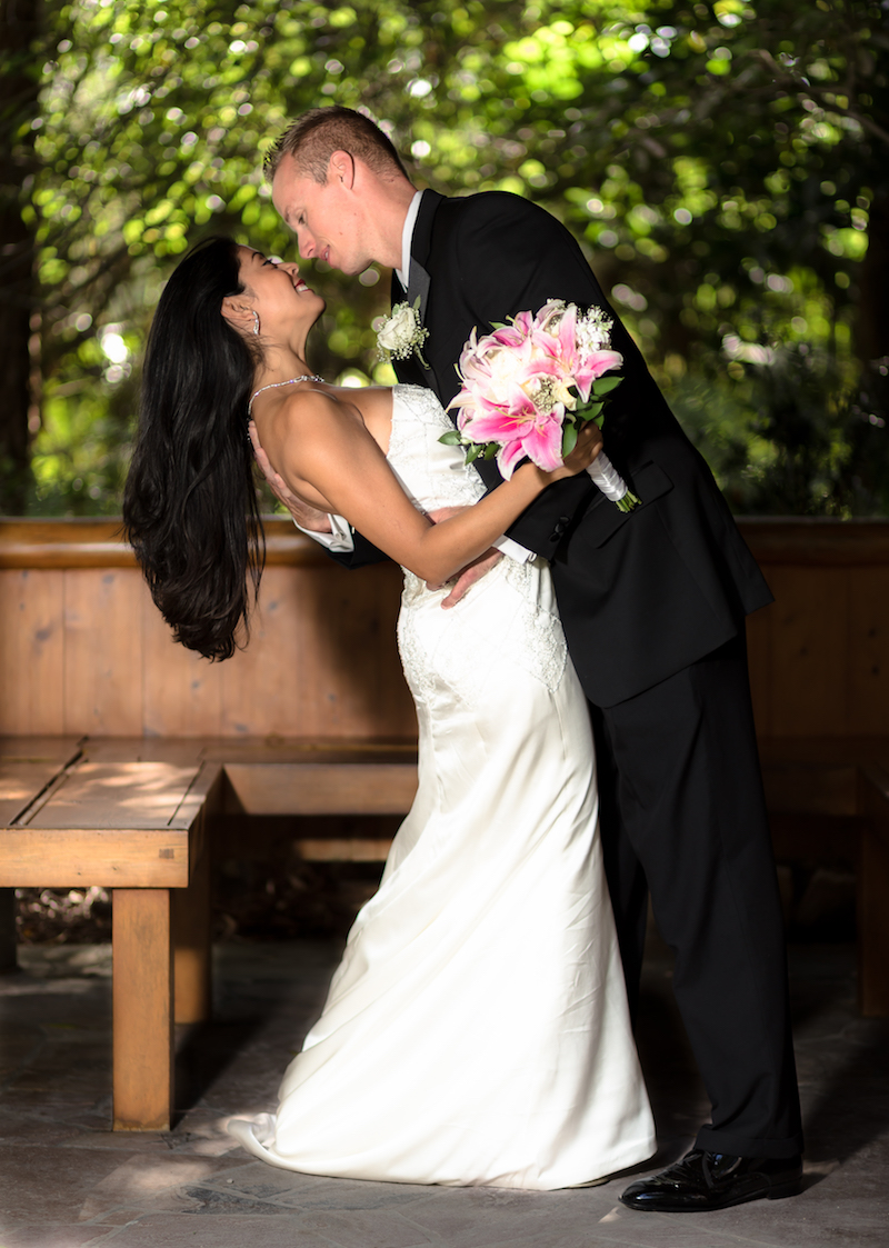 Wedding Photography at Morikami Japanese gardens by Delray Beach Wedding Photographer. Bride and groom kissing at Morikami Japanese Gardens Delray Beach Florida