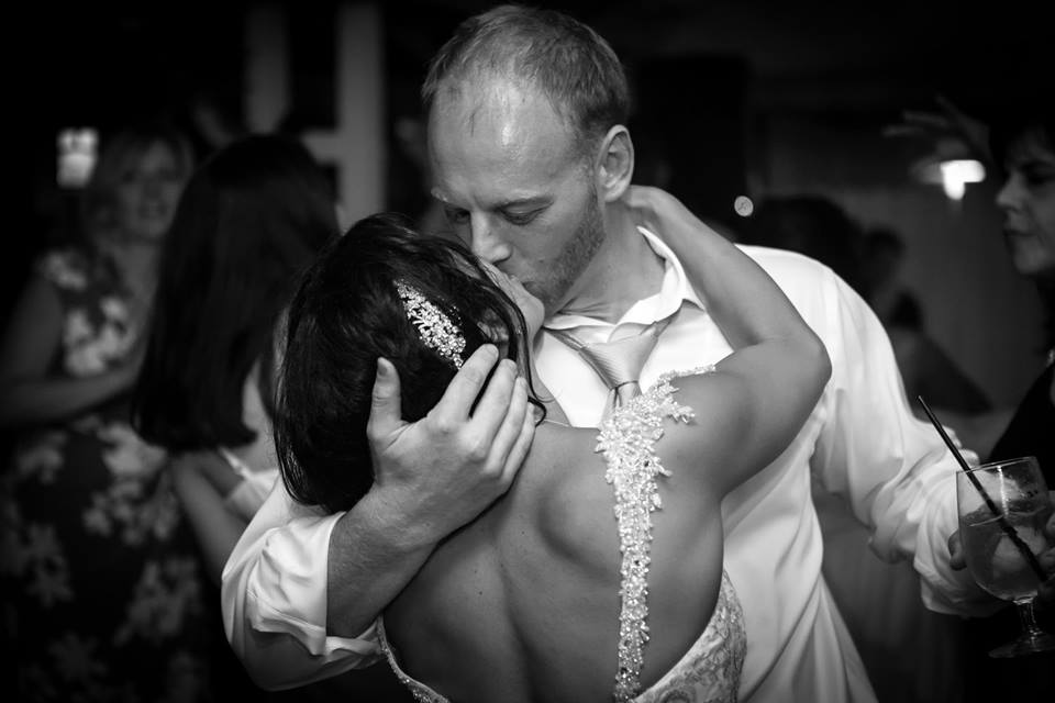 Finding South Florida Photographers for Engagement and Wedding Photography by Couture Bridal Photography South Florida Wedding Photographers. Image of bride and groom during their wedding reception dancing and a romantic kiss