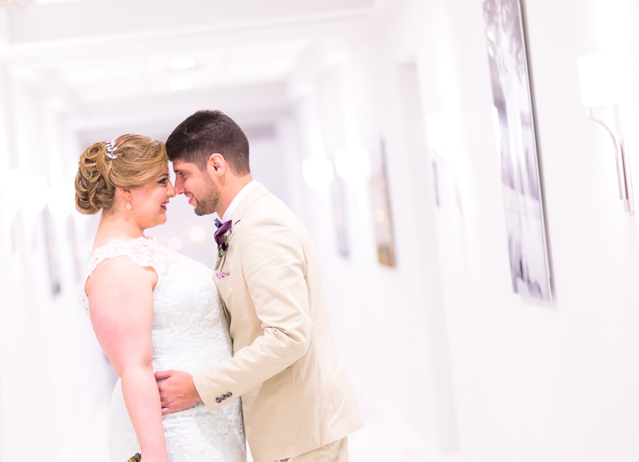 Couture Bridal Photography is a Fort Lauderdale Wedding Photographer that offers amazing wedding photography at the Bonaventure Country Club. Bride and groom in the hallway of Bonaventure Country Club for a bridal portrait.