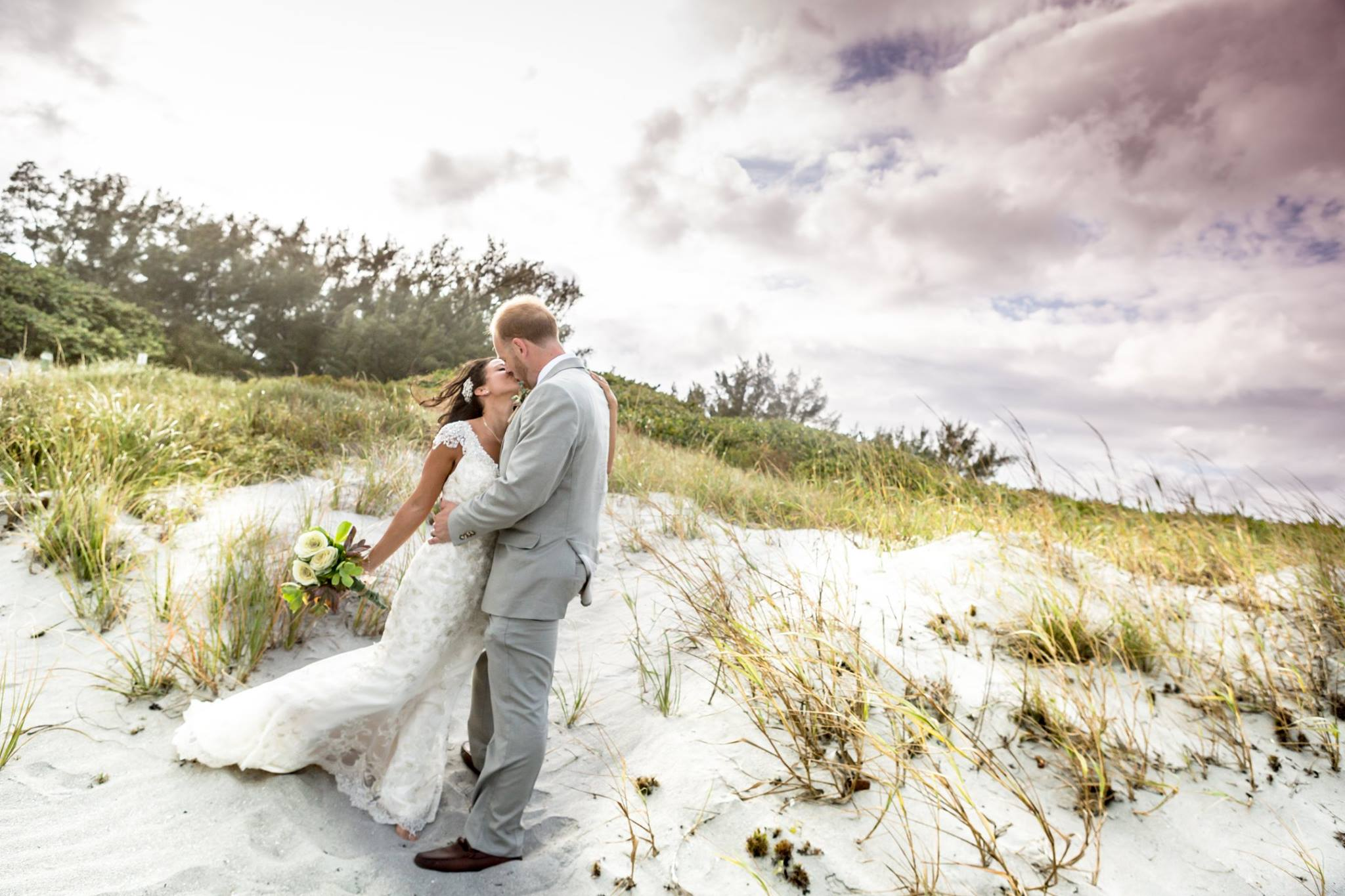 Wedding Photography Videography image of bride and groom on Delray Beach after wedding day ceremony by Fort Lauderdale Photographer Alfredo Valentine Couture Bridal Photography